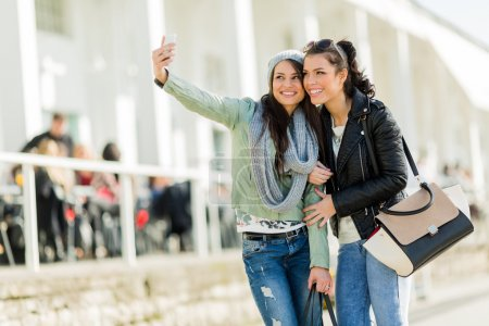 Women taking a self portrait of themselves