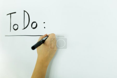 Photo pour Writing todo onto a white writing board - image libre de droit