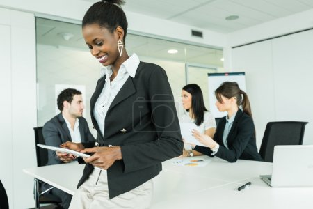 Businesswoman using a tablet at an office meeting