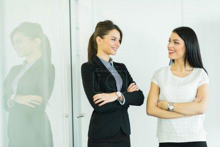 Businesswomen talking in an office
