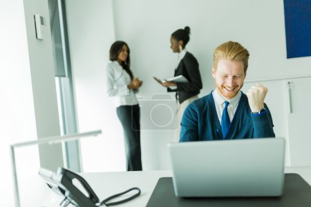 Businesman being happy for achieving his goals