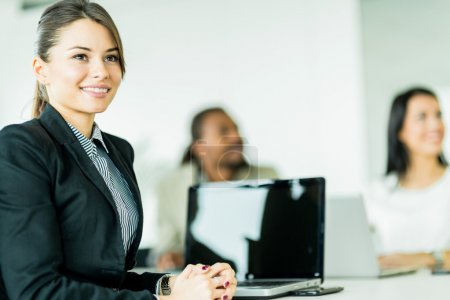 Successful businesswoman sitting in office