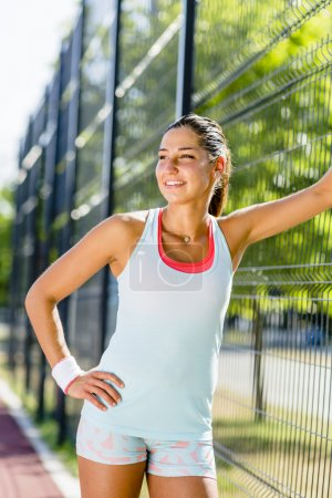 Athletic woman smiling outdoors