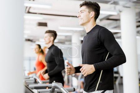 Group of people using treadmills