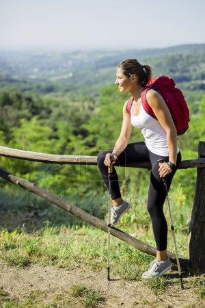Beautiful hiker woman enjoying the view