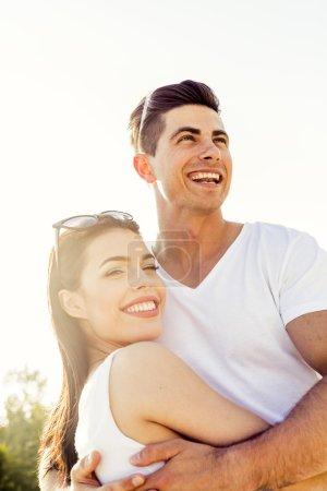 Beautiful couple hugging in summer