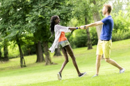 Beautiful couple dancing outdoors in a park