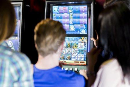 Friends gambling in a casino