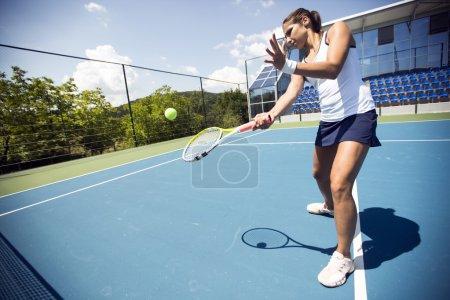 Tennis player performing a drop shot