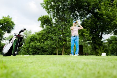 Golfer getting ready to hit