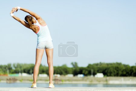 Woman stretching and relaxing in the city