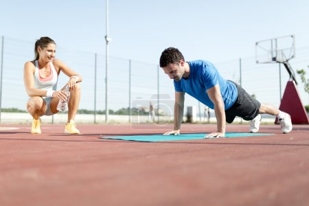 Woman and personal trainer counting push