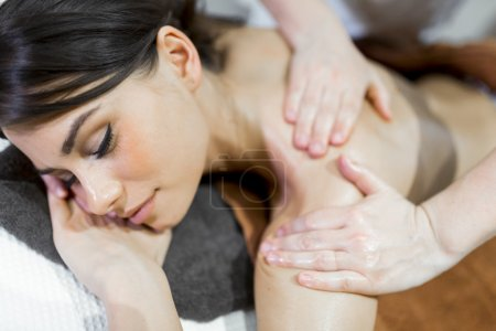 Beautiful woman lying on a massage table