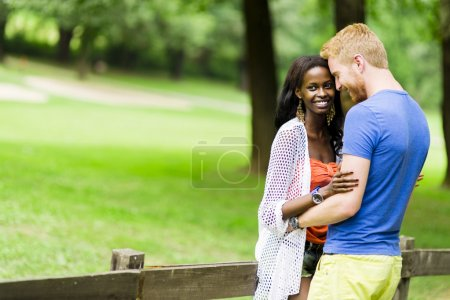 Photo for A happy couple in love spending some time together outdoors in a park and being romantic - Royalty Free Image
