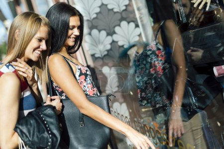 Two beautiful women shopping