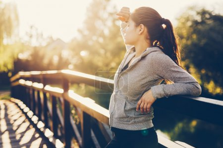 Photo for Beautiful female tired after jogging taking a break - Royalty Free Image
