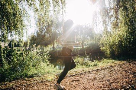 Beautiful woman jogging in nature