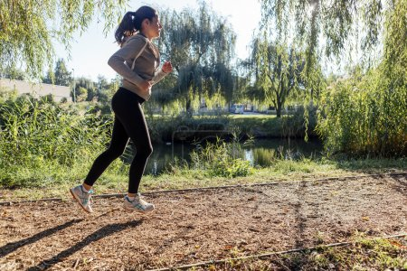Photo for Beautiful woman jogging in  a park - Royalty Free Image