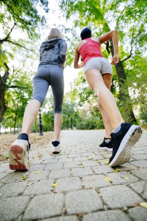 Photo for Women jogging in park and living a healthy sporty life - Royalty Free Image
