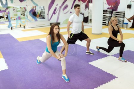 People exercising in fitness club
