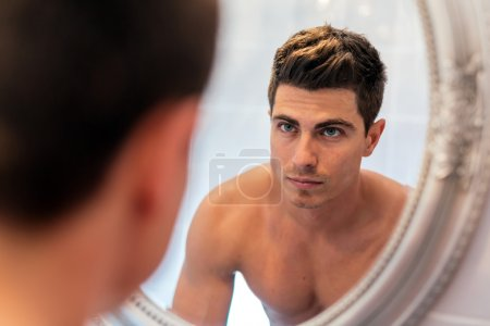 Handsome man in mirror
