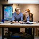 Постер, плакат: Designers working in modern office