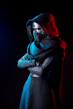 Portrait of Darth Vader costume replica with grab hand and his sword .