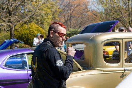 Man Smoking at a Classic Car Show