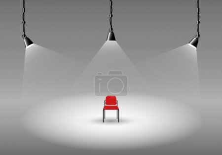 Empty photo studio with spotlights and chair
