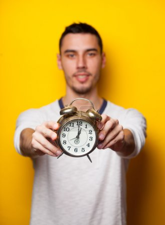 portrait of young man with clock