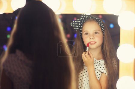 Young girl with lipstick