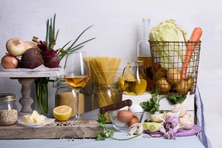 Healthy food ingredients. Variety of grocery products including vegetables on kitchen table.