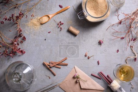 Ingredients for sweet preserves: sugar, cinnamon, wine on grey surface. Autumn mood background. Copy space, top view.