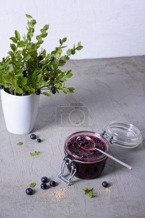 Fruit dessert, jam made of blueberries and blueberry bushes.