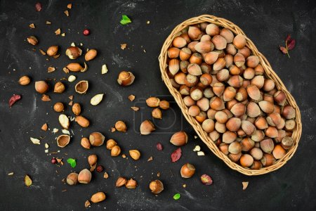 Basket of Hazelnuts in a nutshell, cracked nuts, autumn leaves,