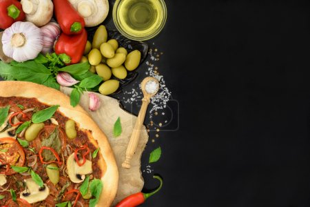 Photo for Vegetarian pizza on wooden board with vegetables. Space for text, top view. - Royalty Free Image