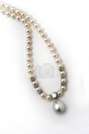 Beautiful pearl necklace isolated on white background