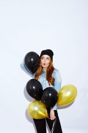 Stylish girl with balloons on white background