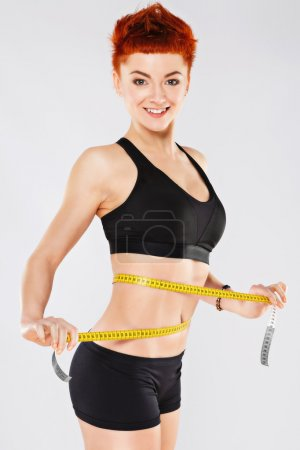 Sportive girl at gray background