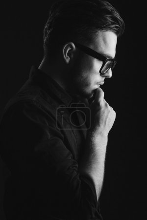 Attractive brunette man on black shirt and glasses
