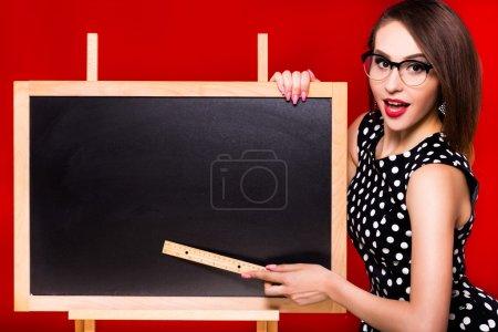 Woman standing near the blackboard