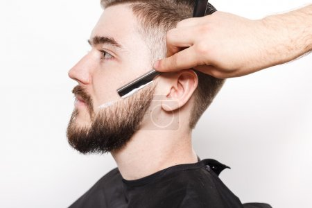 Close up portrait of a man getting a close shave