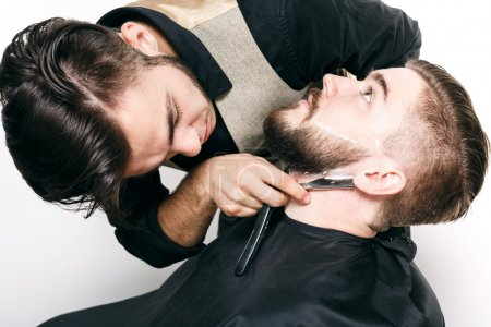 Young barber and customer