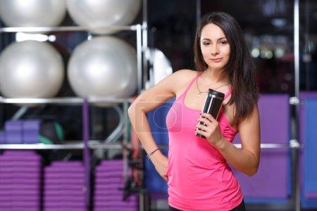 Slim girl posing in the gym