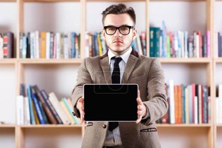 Man holding digital tablet