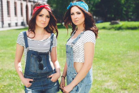 twins sisters wearing bandanas and overalls