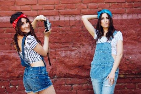 Happy twins brunette girls