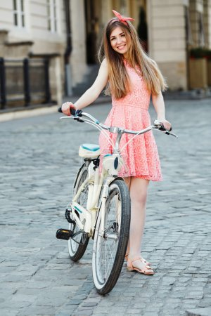 girl with bicycle on street