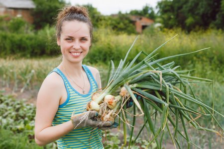 Woman with bunches of onion