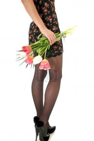 Rear view of female long legs in nylon black stockings and shod